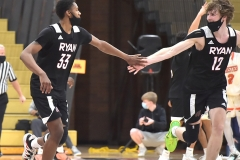 Archbishop Ryan's (33) Aaron Lemon-Warren gets congratulations from (12) Christian Tomasco as he scored in the fourth quarter of the PIAA state semifinals as the Clippers 85-63 to end their season.
