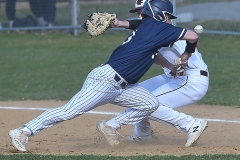 Malvern Prep senior (3) Josh Smith  makes return to first on the pick off attempt as West Chester Henderson's (16) Dean O'Neill can't handle the throw. Smith went to second on the passed ball in the third inning.