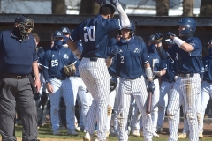 Malvern Prep's  (20) Loonie White is welcomed by teammates after stroking a two run homrun in the first inning against West Chester Henderson.