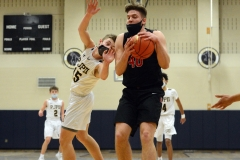 Boyertown's Chris Kiefer, left, hauls down a rebound as Pope John Paul II's JP Baron reaches out for the ball. (Owen McCue - MediaNews Group)
