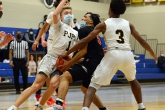 Pope John Paul II's Kevin Green, left, and Mike Wells, right, defend Boyertown's Aarick Salata on his way to the hoop. (Owen McCue - MediaNews Group)