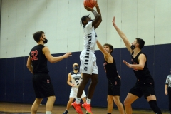Pottstown's Nyles Bunn-McNeil, center, shoots over Boyertown's Tre Diguglielmo, right, on Monday. (Owen McCue - MediaNews Group)
