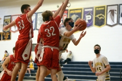 Upper Perkiomen's Jack Cupitt (22) goes up for a shot as Owen J. Roberts' Preston Brindle (32) and Brody Bolyn (33) defend. (Owen McCue.- MediaNews Group)