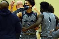 Pottstown's Darius Smallwood (3) is congratulated by teammate Jahzeel Watson (4) after hitting a last-second shot against Pottsgrove on Wednesday. (Owen McCue - MediaNews Group)
