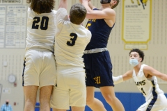Pope John Paul II's JP Baron, right, Shoots over Spring-Ford's Alex Lewis (20) and Zack Skrocki (3). (Owen McCue - MediaNews Group)
