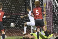 Spring-Ford's (9) Justin Russell puts a rebound past West Chester East goalie Trey Regester  to score the only goal in District playoff action at West Chester East Thursday night.