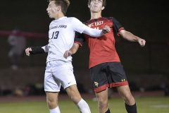 Spring-Ford's  (13) Connor Lynch and West Chester East's (11) Jason Leyden battle for a header in the second period. Spring-Ford went on to win 1-0 in District playoff action at West Chester East Thursday night.