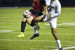 West Chester East forward (5) William Cortese tries to control the ball against Spring-Ford's (10)Akshay Patel in the first period. Spring-Ford went on to win 1-0 in District playoff action at West Chester East Thursday night.