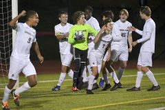 Spring-Ford players embrace goalkeeper Eric Moriarity after he made a save on a penalty kick by West Chester East's (4) Ryan Cogill in the second period. Spring-Ford went on to win 1-0 in District playoff action at West Chester East Thursday night.