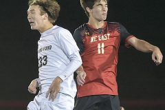 Spring-Ford's  (33) Tommy Bodenschatz and West Chester East's (11) Jason Leyden battle for a header in the second period. Spring-Ford went on to win 1-0 in District playoff action at West Chester East Thursday night.