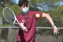 Conestoga's Peter Asulander returns a shot against Unionville's Andrew Poprick in singles tennis at Unionville Monday afternoon.
