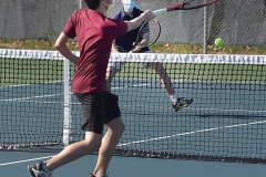 Conestoga's Manas Dhawanhits a ball towards Unionville Nate Butler in doubles tennis Monday afternoon at Unionville.