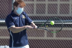 Unionville's Andrew Poprick returns a shot against Conestoga's Peter Asulander in singles tennis at Unionville Monday afternoon.