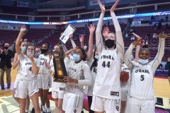 Cardinal O'Hara's (3) Amaris Baker holds up the PIAA Girls 5A CVHampionship trophy as the Lions defeated Chartiers Valley Saturday evening by a score of 51-37 to win their first PIAA title in team history.