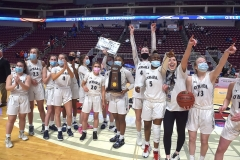 Cardinal O'Hara celebrates the PIAA Girls 5A Championship trophy as the Lions defeated Chartiers Valley Saturday evening by a score of 51-37 to win their first PIAA title in team history.