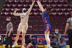 Cardinal O'Hara's (44) Maggie Doogan blocks a Chartiers Valley shot in the first half Saturday evening at the Giant Center. The Lions won by a score of 51-37 to win their first PIAA title in team history.