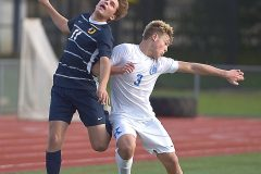 Unionville's (11)Hunter Darlington and Kennett's (3) Rthan Wentzal go for the same header in the first  period against Tuesday at Unionville High School. U went on to a 3-0 victory.
