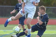 Kennett's Vincent Poncet and Unionville's (14) Haden Quillman battle for a loose ball in the first half.