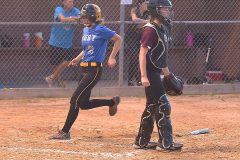 Downingtown West's Emma Eadie scores the winning run for the 3-2 victory.
