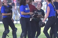 Morgan Dey, center right, is all smiles as she is celebrated by her teamamtes after she hauled in the final out to secure the 3-2 victory.
