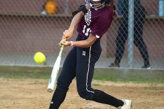 West Chester Henderson's Grace Abbonizio strokes a triple and went on to score.