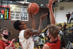 Chester's (1) Fareed Burton hits a basket to draw the Clippers within three with less than a minute remaining. The Clippers came back to defeat Crestwood in overtime of the PIAA quarterfinals Friday evening.