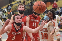 Crestwood's Ryan Petrosky and Chester's  Karell Watkins grab for a loose ball with seconds remaining as the Clippers defeated Crestwood in overtime of the PIAA quarterfinals Friday evening.