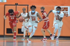 Chester's (30) Karell Watkins leads the charge up court in the second quarter as the Clippers defeated Crestwood in overtime of the PIAA quarterfinals Friday evening.