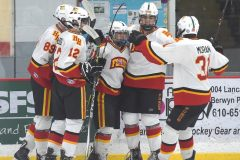 Haverford's Alex Gattone, center, is embraced by teammates after scoring  the first goal against Pennridge in the first period of the the Flyers Cup AA quarter-finals at the Skatium. The Fords cruised to a 8-1 victory.