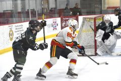 Haverford's (89) Jacob Orazix turns on Pennridge's goal in the first period of the the Flyers Cup AA quarter-finals at the Skatium. The Fords cruised to a 8-1 victory.