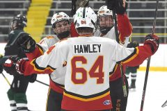 Hugs all around. Haverford's (4) Dan Quartapella, (16)  Jaguar McClelland and (64) Quinn Hawley embrace after McClelland made it 4-1 over Pennridge in the first period in Flyers Cup action at the Skatium.