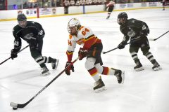 Haverford's (64) Quinn Hawley carries the puck into the zone against Pennridge in the first period of the the Flyers Cup AA quarter-finals at the Skatium. The Fords cruised to a 8-1 victory.