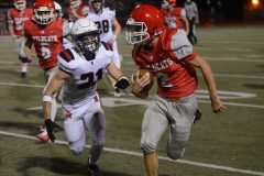 Owen J. Roberts' Avrey Grimm, right, runs up the sideline as Boyertown's Jon Myers chases. (Owen McCue - MediaNews Group)