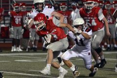 Owen J. Roberts' Hunter Rhoads, left, runs out of the grasp of Boyertown's Aaron Smith on Friday. (Owen McCue - MediaNews Group)