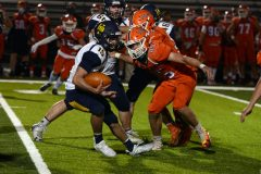 Upper Perk's Hunter Flack (15) tries to escape Perkiomen Valley's Gage Young on Friday. (Owen McCue - MediaNews Group)