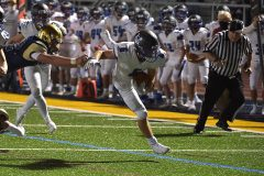 Great Valley's (6) Michael Corrigan dives for his second second quarter touchdown to lead the Patriots to victory.