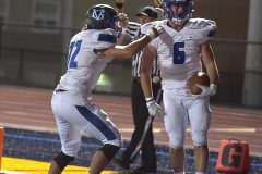 Great Valley's (6) Michael Corrigan reacts after his second second quarter touchdown to lead the Patriots to victory.