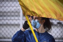 Sun Valley color guard member Skylar Hermann wears her mask during the game.