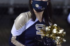 A Sun Valley cheerleader wears her mask during the game.