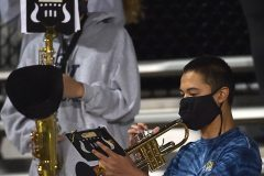 Sun Valley band members toot their horns with covers over the opening and wearing masks to minimize the opening.