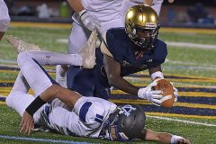 Sun Valley defender (32) Sean Stone recovers a first half fumble by Great Valley quarterback (11) Andy Talone.