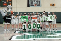 The Methacton girls basketball poses after junior Nicole Timko, holding flowers, scored her 1,000th career point in a win over Pope John Paul II on Tuesday. (Owen McCue - MediaNews Group)