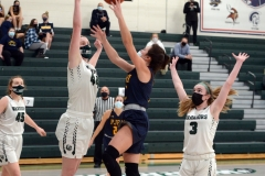 Pope John Paul II's Tess Crossan, center, attempts a shot as Methacton's Mairi Smith, left, and Cassidy Kropp, right, defend. (Owen McCue - MediaNews Group)