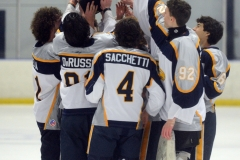 The Spring-Ford ice hockey team hoists the trophy following Wednesday's ICSHL Pioneer championship game win over Perkiomen Valley at Center Ice. (Owen McCue - MediaNews Group)
