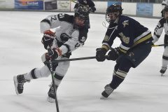 Strath Haven's (12) Josh Peabody skates on Sun Valley's (98)Patrick Brees in the second period at IceWorks in Aston Monday evening.