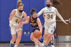 Springfield's (41) Mia Valerio steals a ball on a double team with (34) Lexi Aron in the fourth quarter against Mount St. Joseph (13) Paige Metzler.