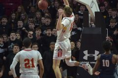 West Chester East's (15) Andrew Carr slams in the second half.