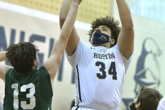 West Chester Rustin's (34) Jacob Barksdale hits a basket in the third quarter as Bishop Shanahan's (13) Will Loughlin defends.