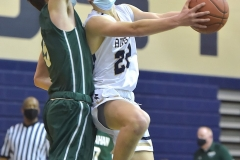 West Chester Rustin's (22) Sam Sproull puts a shot up against  Bishop Shanahan in the second quarter.