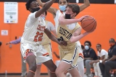 West Chester Rustin's (2) Tyler Guinta tries to keep control of the ball as  employed the press including Chester's (22) Kyree Womak in the third quarter. The Clippers went on to a 62-46 to win the District 1 title.